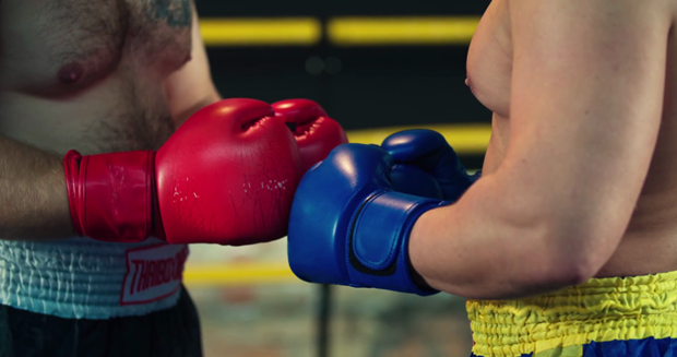 two-boxers-start-a-fight-touch-gloves-each-other-before-combat-4k-video-in-boxing-ring-handshake-respect-tradition-before-sparring-close-up-view_s8w9_y_qe_thumbnail-full01-1024x540