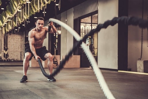 muscular-man-is-doing-battle-rope-exercise