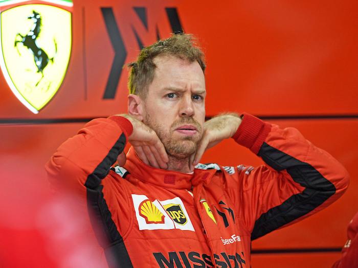 Sebastian-Vettel-garage-looking-stressed