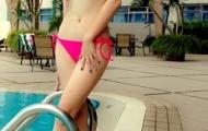 Mi Trần khoe dáng cùng bikini
